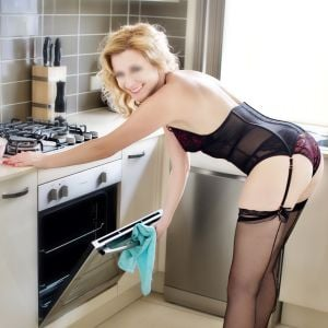 Canberra escort Angelica in the kitchen in high heels, stockings and lingerie