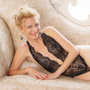 Canberra escort Angelica with blonde hair wearing a black body suit