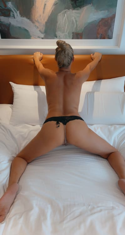 escort Alessandra Rose on a bed in Sydney