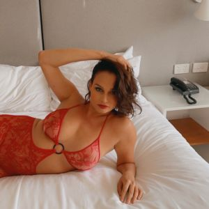Sydney escort Alessandra Rose wearing a red body suit