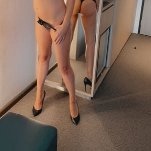 Sydney escort Alessandra Rose in front of a mirror