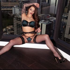 Melbourne escort Alyssa-jade spreading her legs in lingerie and high heels
