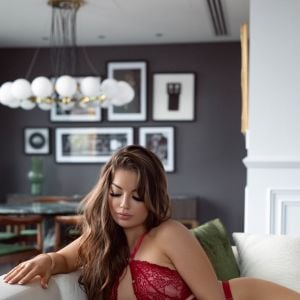 Melbourne escorts - Belle King Belle King in red lingerie on a couch