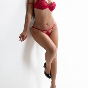 Sydney's Finest Escort wearing red lingerie