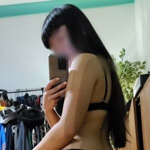 Jade Yen with long dark hair wearing black ankle boots