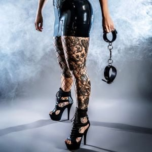 Melbourne Mistress Miss Ayla wearing a kinky outfit and holding handcuffs