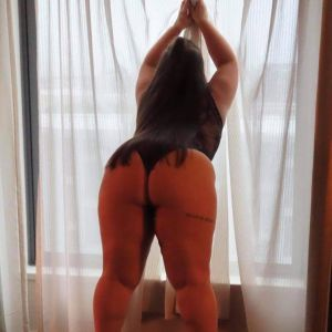 Hot ass Charlie bbw in front of sheer curtains on high heels