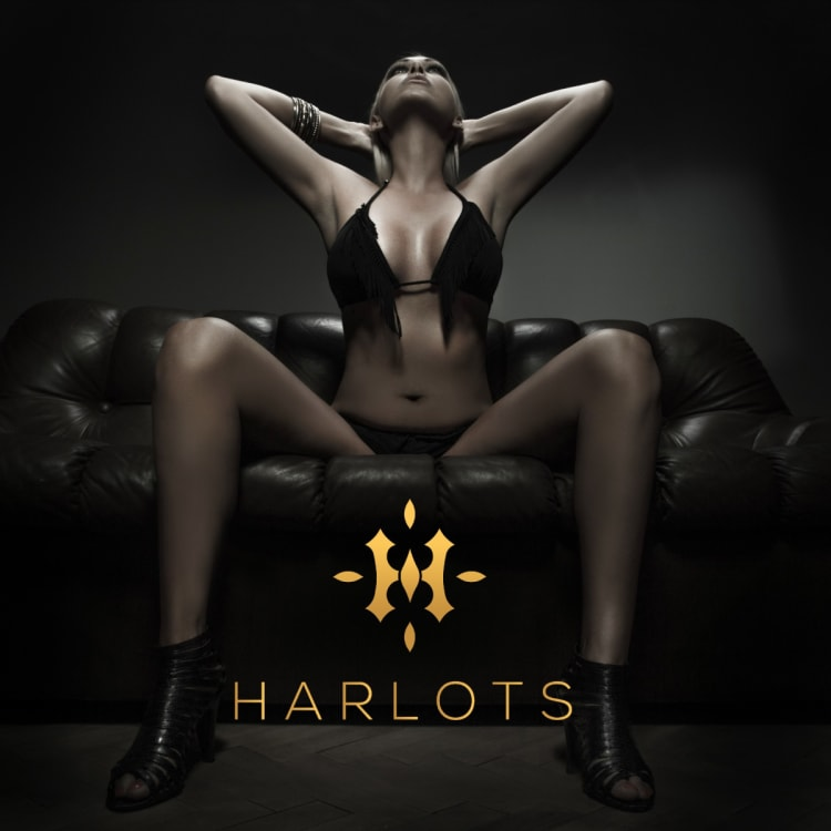 add for Canberra brothel Harlots