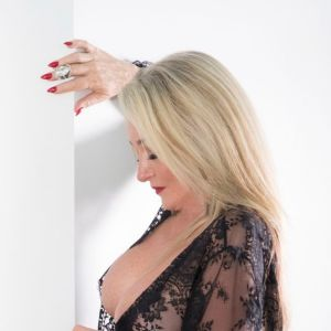 mature escort from Ettalong Beach with blonde long hair dressed in black lace