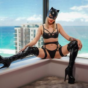 Sydney escorts - Kat Squirt dressed as a naughty catwoman wearing black thigh high boots