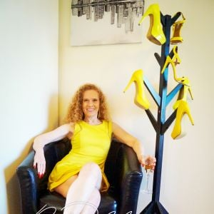 Melbourne escort Ruby Maisen in yellow outfit and yellow high heels