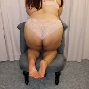 Natalya Roze in a chair