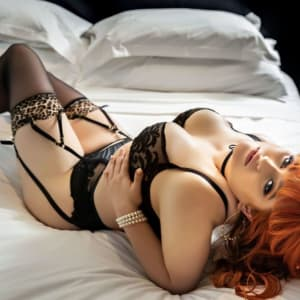 Melbourne escort Allora May in sexy lingerie on a bed for a porn star experience