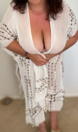 mature Sunshine Coast escorts - Jackie for fun wearing a robe showing her curves