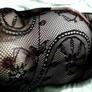 pregnant escort Katy from Perth in fishnet and lace style bodysuit