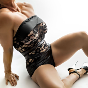 Geelong escort Lily Levine sitting in black see through lingerie and high heels