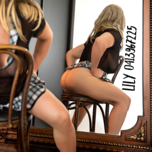 blonde Geelong escort Lily Levine sitting on a chair in sexy outfit