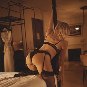 blonde Sydney escort April Evans wearing classy dark lingerie