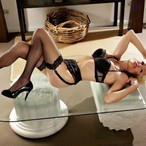 transexual Sydney escort Miss  Rose in lingerie on a glass table