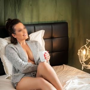 Ingrid unwinding and relaxing with a coffee in bed