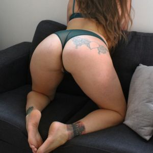 Sydney escort Jessica May showing her butt and tattoos