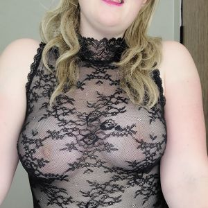 Sydney escort Blossom in see-through lace body showing her breasts and nipples